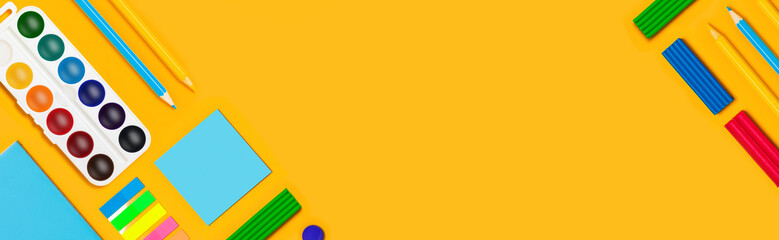 School supplies on yellow  background. Back to school web-banner.