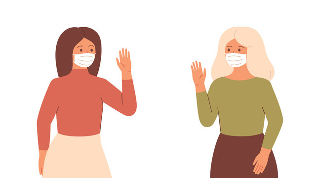 Two women in face masks maintain a social distance by greeting each other. Young woman and mature woman use protective measures against viral infectious disease.Coronavirus epidemic concept