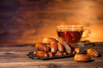 dates and cup of tea, concept of muslim feast holy month Ramadan Kareem, copy space