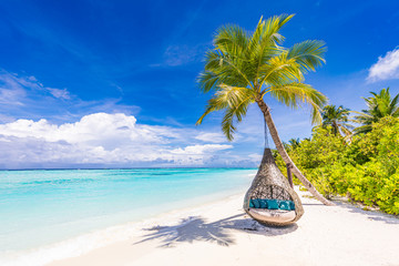 Wall Mural - Tropical beach background as summer landscape with beach swing or hammock and white sand and calm sea for beach banner. Perfect beach scene vacation and summer holiday concept. Boost up color process
