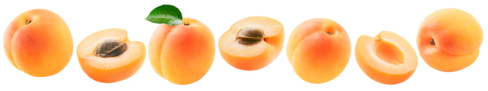 Fresh apricots set isolated on white background. Whole fruit, half pieces with and without pits.