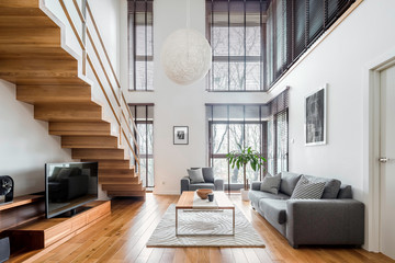 Spacious living room with wooden stairs