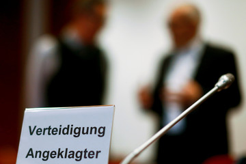 A sign is seen during a break of a trial against British banker accused of involvement in bogus Cum-Ex tax