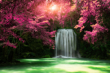 Foto op Plexiglas Zwart Beautiful waterfall with sunlight in autumn forest at Erawan National Park, Thailand, Nature landscape