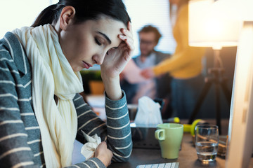 Young office worker feeling unwell