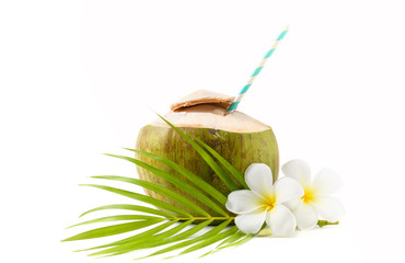 Fresh coconut drink with plumeria flower and paper straw isolated