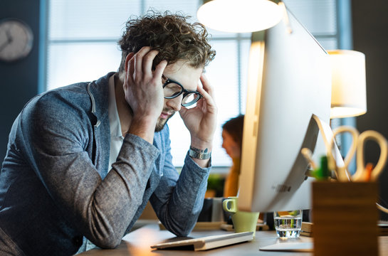 Stressed office worker with headache
