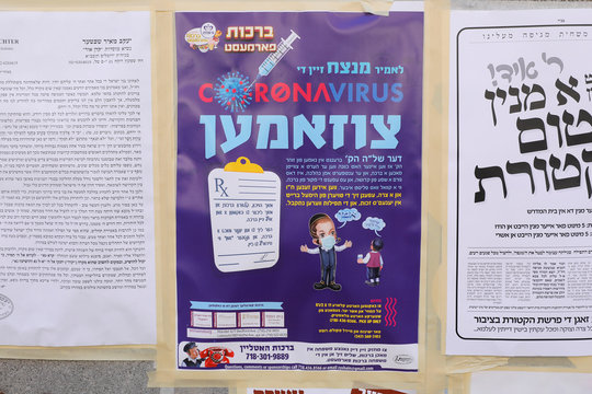 Literature with information about coronavirus disease (COVID-19) is seen posted on a wall in South Williamsburg, a neighborhood with a large community of Hasidic Jewish people, in Brooklyn, New York City, New York