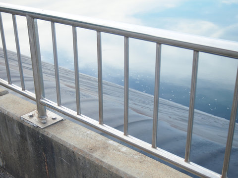 silver stainless steel fence.