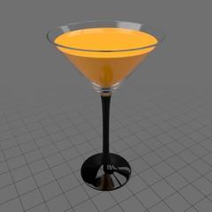 Martini glass with orange juice