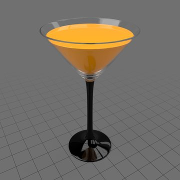 Martini glass with orange juice