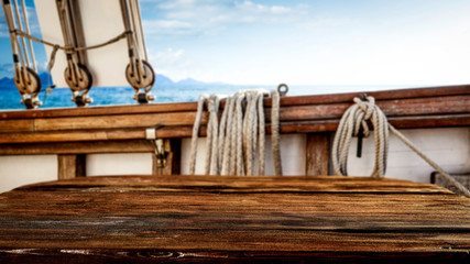 Poster Ship Wooden desk of free space for your decoration and blurred ship deck.Summer sea and blue sky.