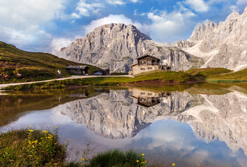 Fotomurales - Majestic Mount with beautiful reflections in the lake. Amazing nature landscape. Wonderful Dolomites Alps.