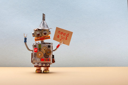 Dismissed robot wants to get a job and looking for an employer. Panicking unemployed robotic worker with a cardboard sign and handwritten text Need a job. copy