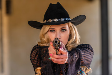 A Lovely Blonde Model Dressed As A Cowgirl Enjoys The American West