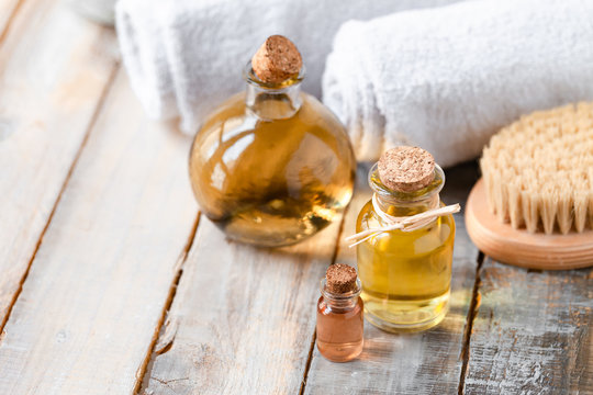 Concept of using natural oil in cosmetology. Moisturizing skin care. Gentle body treatment. Atmosphere of harmony, relax, spa, aromatherapy. Copy space for text, wooden background