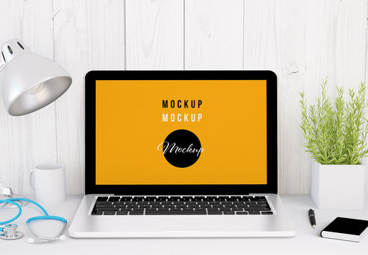 Laptop on Desk with Accessories and Medical Equipment Mockup