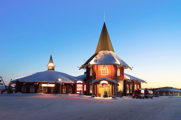 Deurstickers Noord Europa Reception of Santa Claus Holiday Village Lapland at sunset