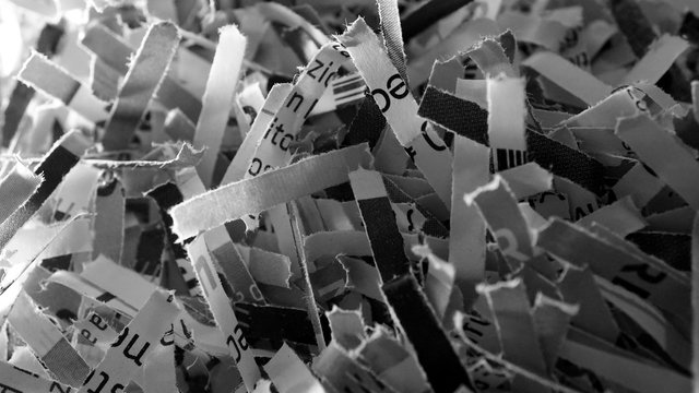 heaps of paper cut by shredder in macro view. conceptual image for privacy, fake news