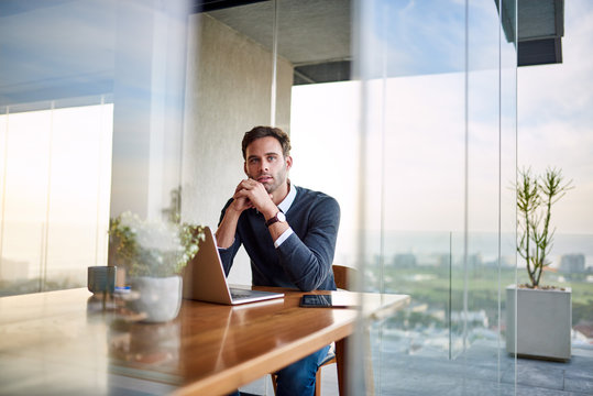 Young businessman deep in thought while working from home