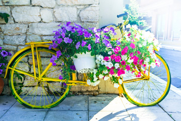 Papiers peints Velo Charming streetdecoration with old bike and blooming flowers