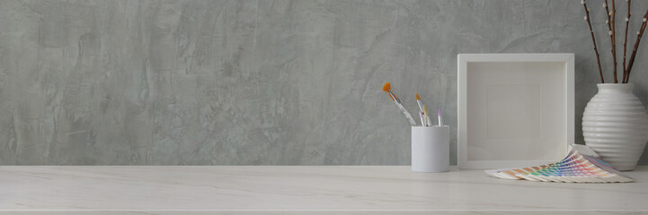 Wall Mural - Cropped shot of trendy workspace with designer supplies and decorations on marble desk