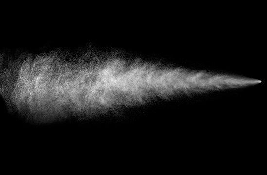 Spray stream from aerosol can on black background