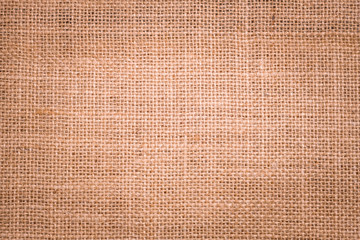 Rough hessian background with flecks of varying colors of beige and brown. with copy space. office...