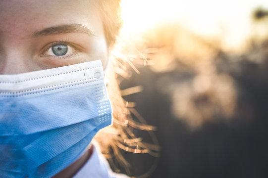 Woman wearing protective mask against coronavirus. Put mask to fight against Corona virus. COVID-19 SARS, SARS-CoV, virus 2020 chinese virus 2019-nCoV