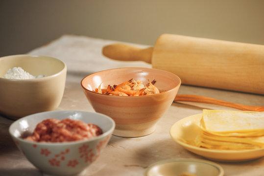 Hong Kong style Wonton ingredients: shrimp, ground pork and wonton wrappers at kitchen