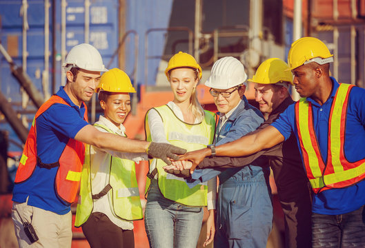 Success Teamwork Concept, Happy business people engineer and worker team joining hands.