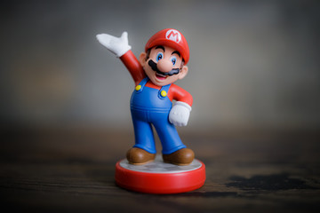 MOSCOW, RUSSIA - March 19, 2020: Super Mario Bros figure character.Super Mario is a Japanese platform video game series and media franchise created by Nintendo and featuring their mascot, Mario.