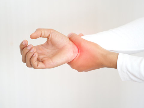 rheumatoid arthritis and repetitive motion injuries,including carpal tunnel syndrome in woman and she touching on her wrist and symptoms of pain and swelling in the hand use for health care concept.