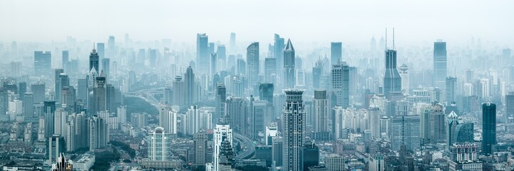 Panoramic view of the Shanghai skyline with skyscrapers covered in smog, China