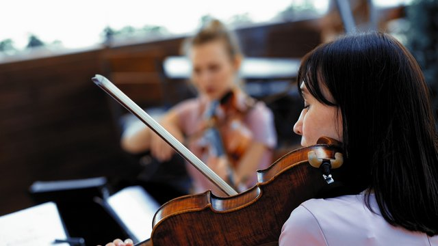 Violin Quartet Playing Classical Music Outside Restaurant, Summer Terrace Or Open Space In Lilliak Dresses On Wedding Ceremony Or Event Intro