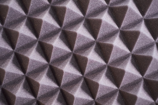 The pattern of the soundproof panel of polyurethane foam. black geometric background
