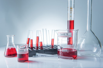 Coronavirus covid19 infected blood sample in sample tube on table in corona virus laboratory