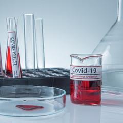 Coronavirus covid19 infected blood sample in sample tube on table in corona virus laboratory