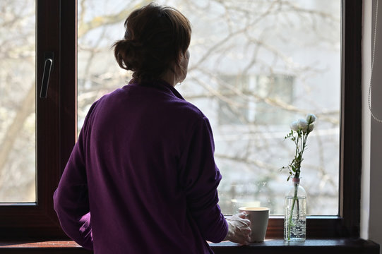 A Self-isolate Woman or Quarantine Looking Out