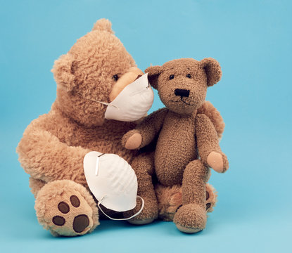 large teddy bear in a white mask transfers the accessory to another, concern for the health of those who are exposing