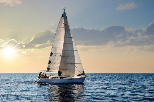 close-up sailboat sailing under a beautiful sunset