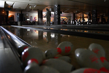 A health worker sprays disinfectant inside a bowling alley due to the coronavirus disease (COVID-19) outbreak in Bangkok