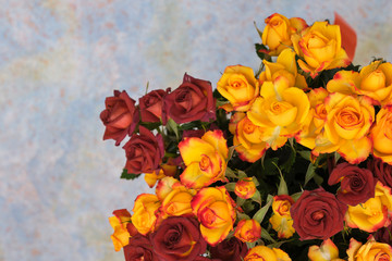 Foto op Canvas Lelie Bouquet and yellow and red bush roses on a blue background.