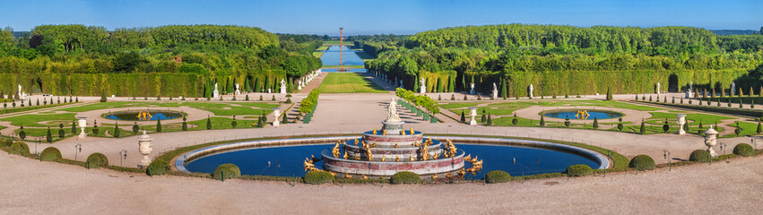 Zelfklevend Fotobehang Parijs Panoramic view of the Versailles Park - the Latona Basin with the Grand Canal in the background under the summer sun, Versailles, France