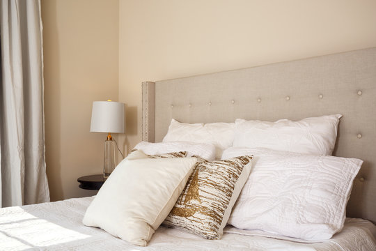 Neutral colored bedroom interior with pillows