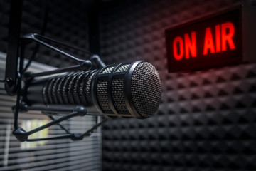 Professional microphone in radio station studio on air