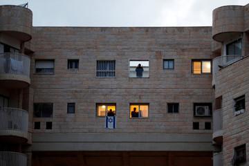 Israelis applaud medical teams fighting the coronavirus outbreak, in Modiin