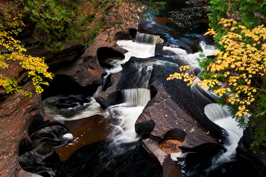 """An area of the Presque Isle River know as """"The Bowls"""" as seen from a suspension bridge overhead."""