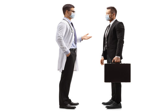 Doctor and businessman with medical face masks standing and talking