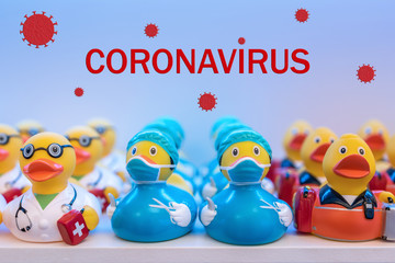 Different rubber ducks with virus masks on the shelf in the store. Minimal Corona virus outbreak Holiday concept.